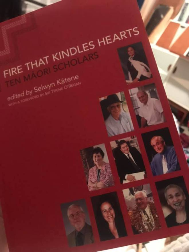 Red book cover titled The Fire that Kindles Heart